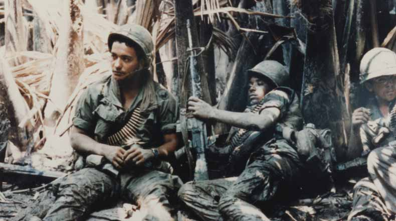 US Army troops taking break while on patrol in Vietnam War.