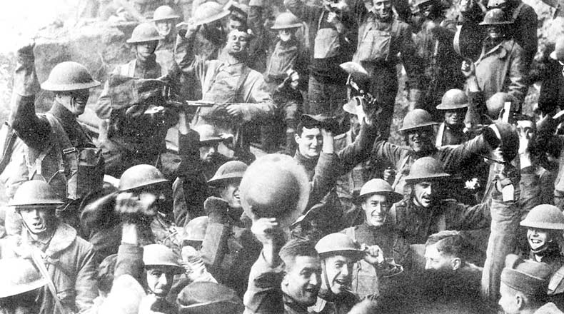 Men of U.S. 64th Regiment, 7th Infantry Division, celebrate the news of the Armistice, November 11, 1918.